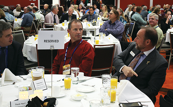 Joshua Tonsager (left) legislative director for the national Association of Wheat Growers sits with Walla Walla County grower Jim Kent (center) and NAWG president and Adams County grower, Brett Blankenship.