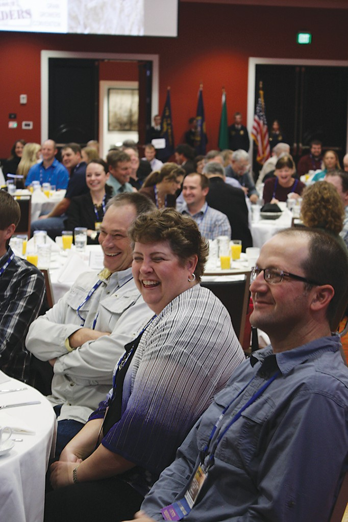 Marci Green (center) and her husband, Lonnie (left), farmers from Spokane County, join Anthony Smith of Benton County at the opening breakfast.