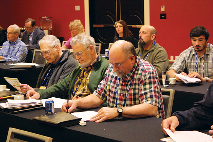 WAWG members reviewing and updating resolutions at the convention.
