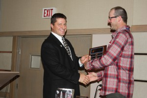 Outgoing WAWG president Kevin Klein (left) named Benton County as the WAWG county of the year. County president Tony Smith accepts the award.