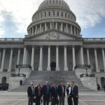 The group takes a break from meetings for a picture outside the Capitol Building.