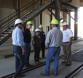The final stop, before heading back to Spokane, was the McCoy Grain Terminal. Tour members watched grain trucks unloading and the grain being tested. They got a crash course in elevator operations and learned how grain piles are used to manage grain flow.