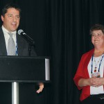 Kevin Klein accepts the Washington Association of Wheat Growers' (WAWG) member of the year award from WAWG President Marci Green during the Washington awards banquet, held during the  2017 Tri-State Grain Growers convention. Klein served as WAWG president from 2015/16.